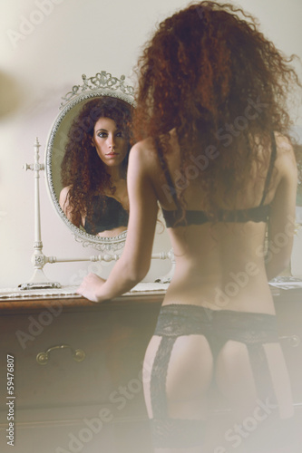 Sensual lingerie woman reflected in the mirror