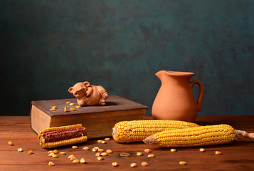 Corn and pigs figures on books
