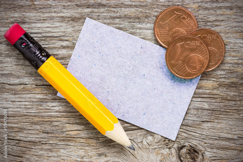Coins with pencil and  paper card