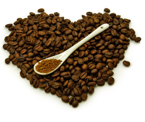 heart made of coffee beans and instant coffee in spoon