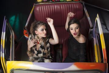 Fashion women in classic car
