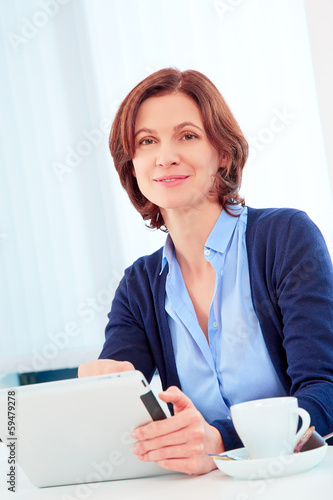 Woman with pad in office