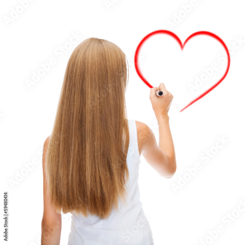 girl in shirt drawing heart on virtual screen