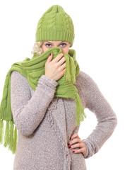 Young woman wearing warm sweater with wool scarf