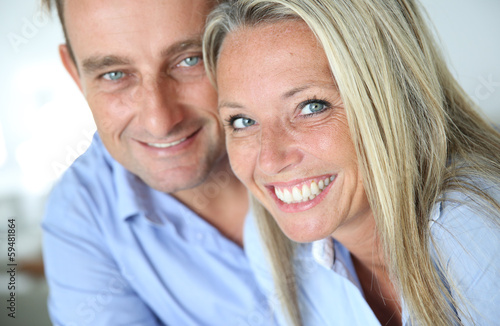 Portrait of cheerful blond couple