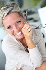 Portrait of smiling mature woman with eyeglasses