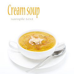 cream soup of yellow lentils in a white bowl, isolated