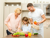 happy family making dinner in kitchen