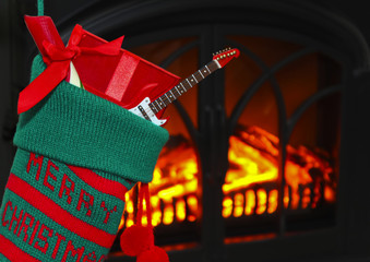 A Guitar in a Stocking at Christmas