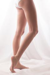 Barefoot girl posing. High key shot