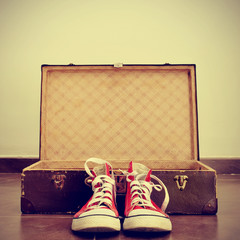 sneakers and old suitcase