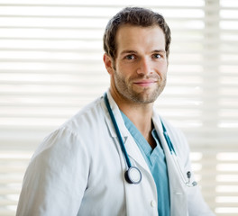 Confident Cancer Specialist With Stethoscope Around Neck