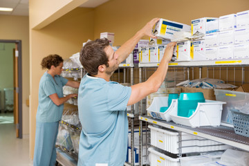 Nurses Arranging Stock In Storage Room