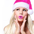 Christmas Woman. Glamour Surprised Blonde Girl in Pink Santa Hat
