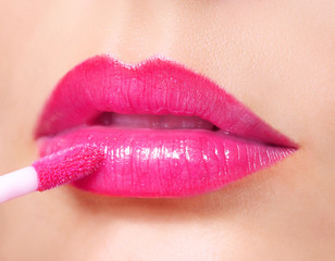 Hot Pink Lipstick. Lip Gloss on Sexy Lips and Brush. Makeup.