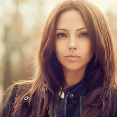 Outdoor fashion portrait of young beautiful woman - close up