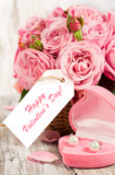 Pink roses and gift in a basket