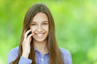 smiling teenage girl talking on mobile phone