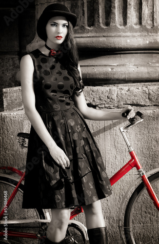 lady with bicycle