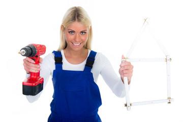 handwerkerin mit bohrmaschine