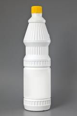 White detergent plastic bottle isolated on gray