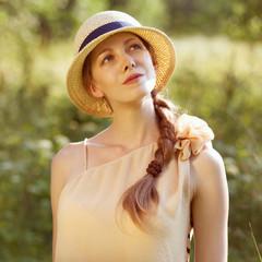 Happy girl in a straw hat