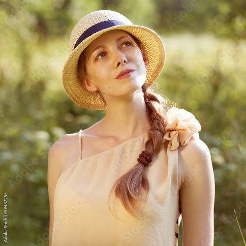 Happy girl in a straw hat