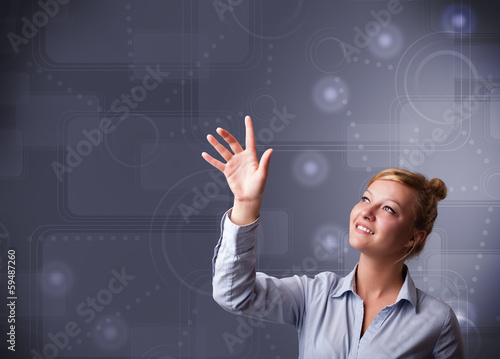 Young businesswoman touching copy space