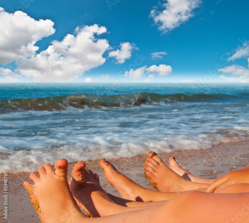 bare feet of children on the beach