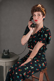 Pinup Girl in Flowered Smirks with Phone