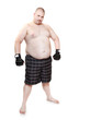 Overweight man with boxing gloves.