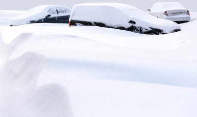 Cars buried in deep snow