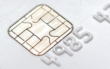 Macro shot of the chip on the white credit card.