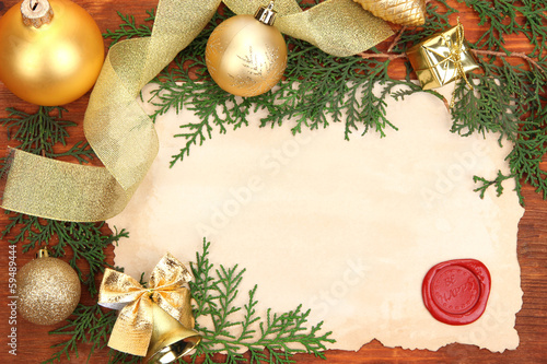 Frame with vintage paper and Christmas decorations
