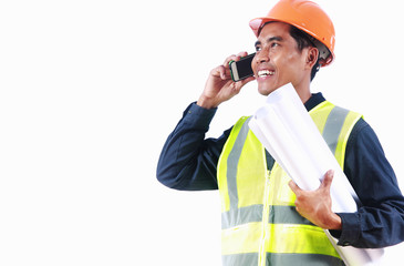 Smiling engineer holding blueprint talking on the phone
