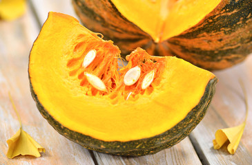 Pumpkin  on wood background.Healthy eating-