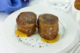 Filet mignon wrapped in bacon with sweet sauce