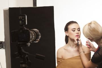 Beautiful model preparing for a photo shoot