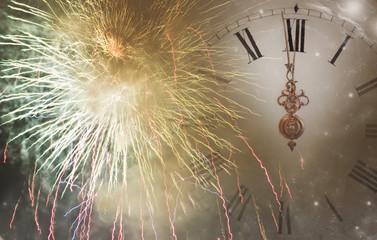 Vintage clock against holiday lights