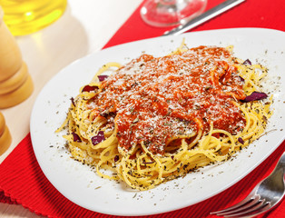 Pasta with tomato sauce and parmesan cheese