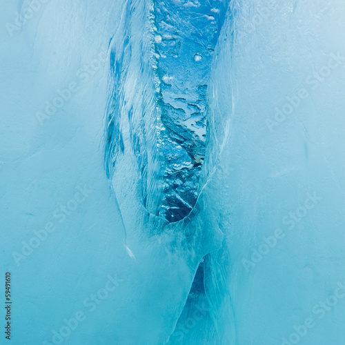 Underwater crevasse in thick layer of floating ice