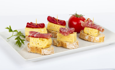 thin slices of Iberian sausage omelette with bread