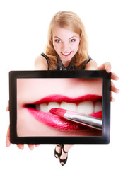 Girl showing ipad tablet touchpad with photo of lips lipstick