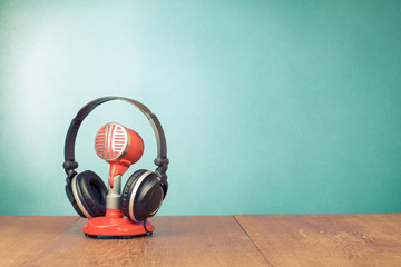 Old style red microphone, headphones for retro background