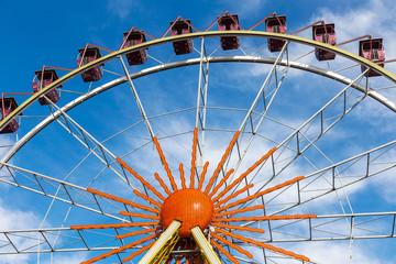 Ferris wheel against a blue sky on a sunny day
