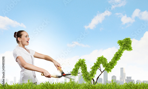 Woman cutting bush