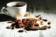 Cocoa powder in cup on wooden table