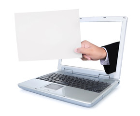 Hand carrying blank paper out of a laptop screen