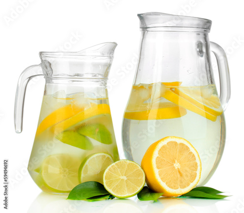 Cold water with lime, lemon and ice in pitchers isolated