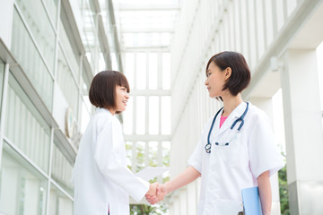 Asian medical doctors shaking hands